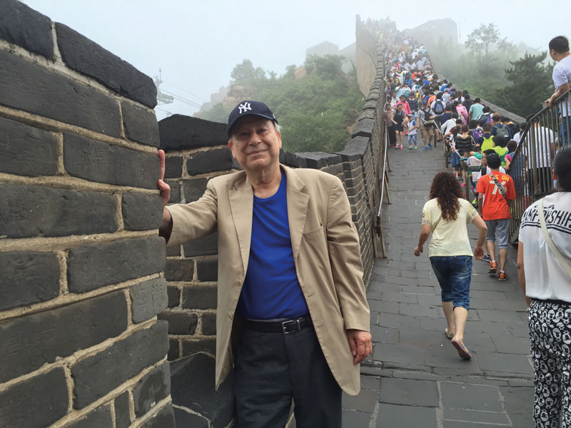 Akbar Ahmed at the Great Wall with New York baseball cap