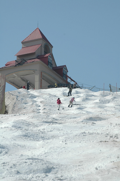 Spring skiing and snowboarding at Nanshan Ski Center, Beijing, China.